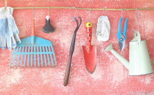 Gardening supplies hanging neatly on wire from s-hooks